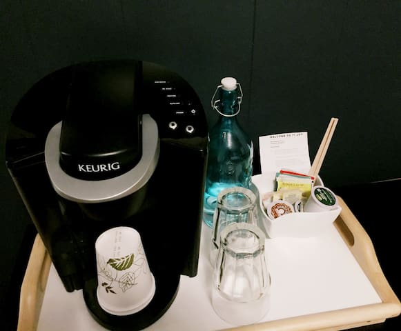 Coffee machine and water bottle available in the room