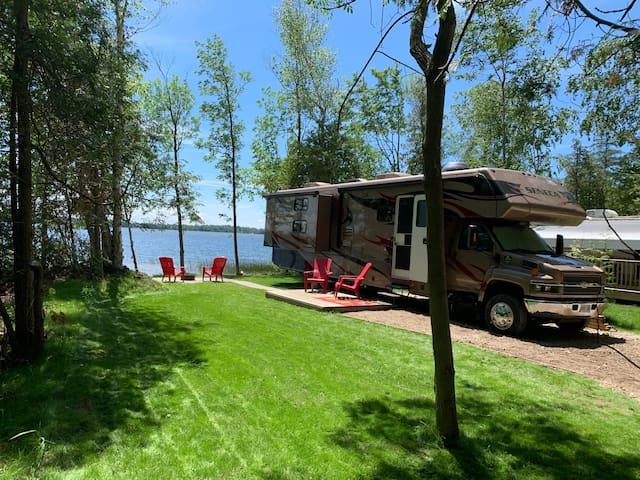 Motorhome  on Waterfront Site at Family Campground