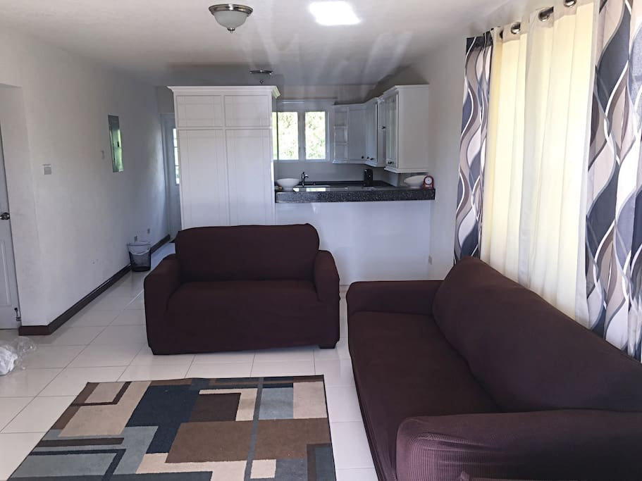 Spacious living room with 3-piece set: 1 chair, 2-seater love seat and 3-seater couch.