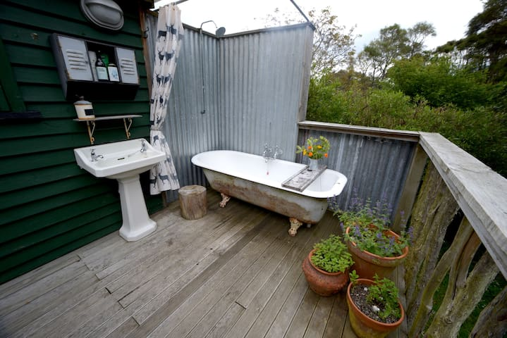outside bathroom with hot running water