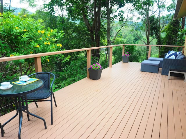 Your private deck overlooks the valley and Currumbin Creek. A great spot to chill out with a drink or a good book.