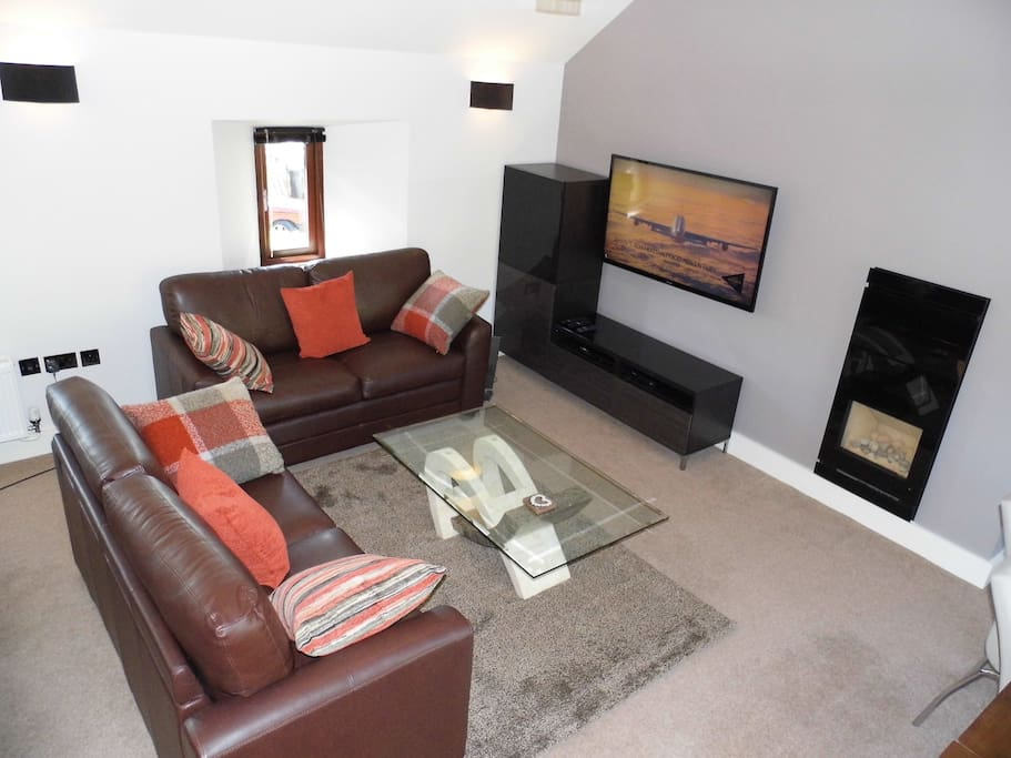 """Living Area with 50"""" Colour TV, DVD & CD Player"""
