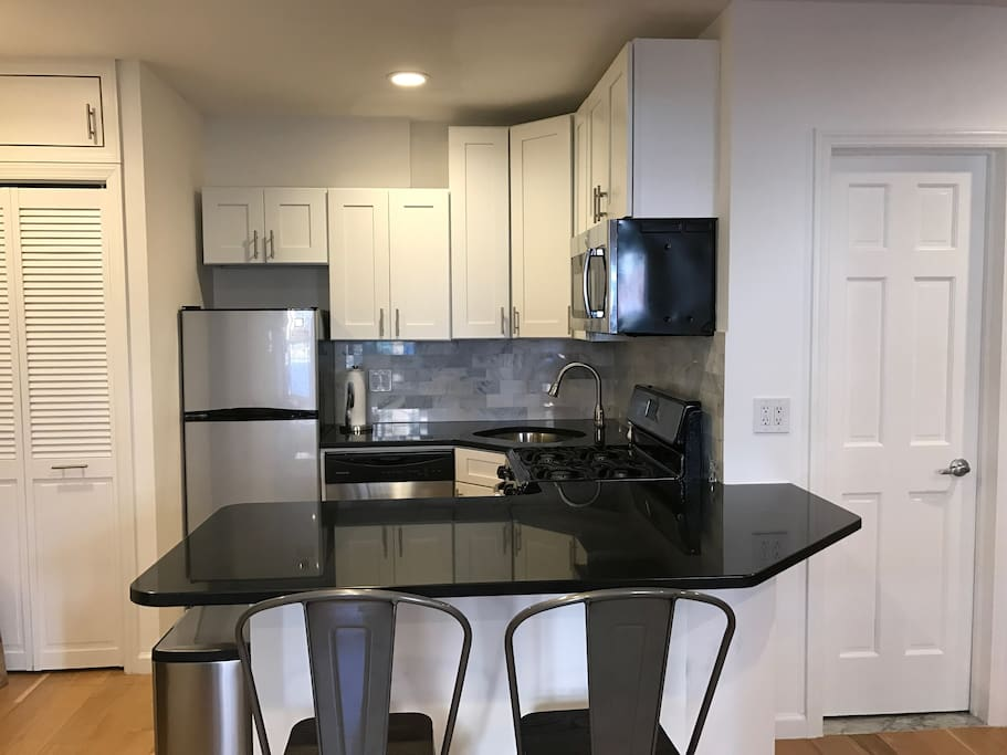 Renovated kitchen with dishwasher and microwave