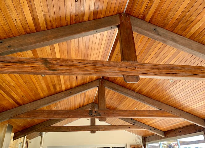 Exposed timber ceiling.