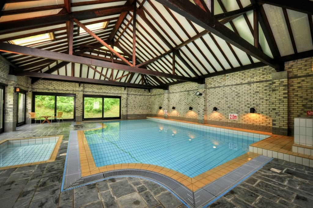 The shared indoor heated pool with hot tub and toddler splash pool