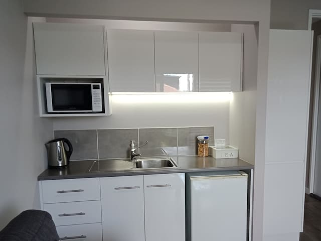 Plenty of cupboards in your kitchenette.  Fridge,  microwave,  electric fry pan,  toaster and crockery  supplied.