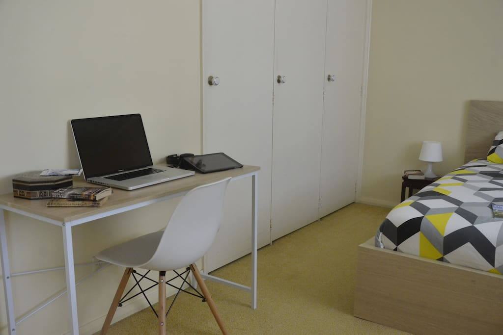 The master bedroom is furnished with a small desk for any writing or computer activities...