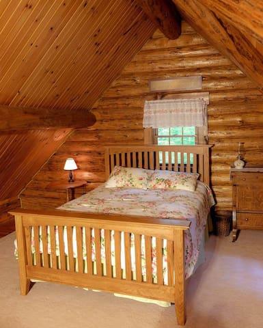 Queen size bed in cabin loft