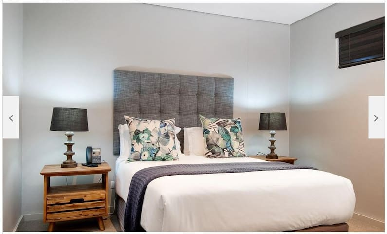 Main Bedroom with double bed, TV and ensuite bathroom.