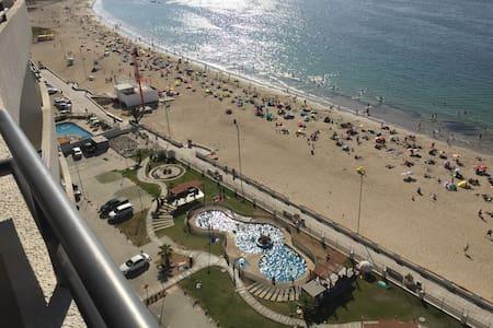 La playa a tus pies en la herradura Piso 16 - 科金博 - 公寓