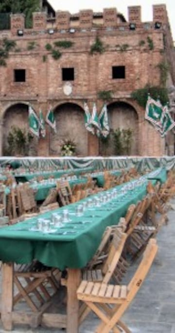 the Official Dinner before the Palio...just in front of your windows.