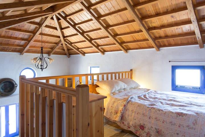 Mezzanine bedroom with built-in wardrobe