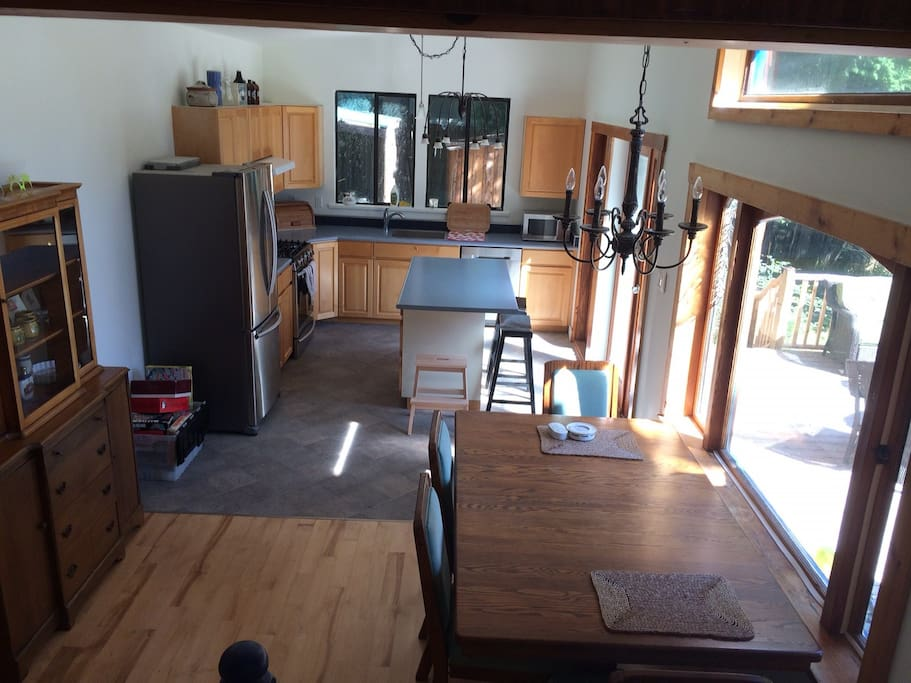 The kitchen has new appliances, including a gas range, and a large BBQ on the deck.
