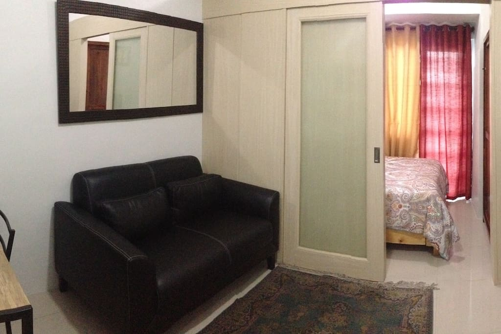 3. Living area and bedroom viewed from kitchen