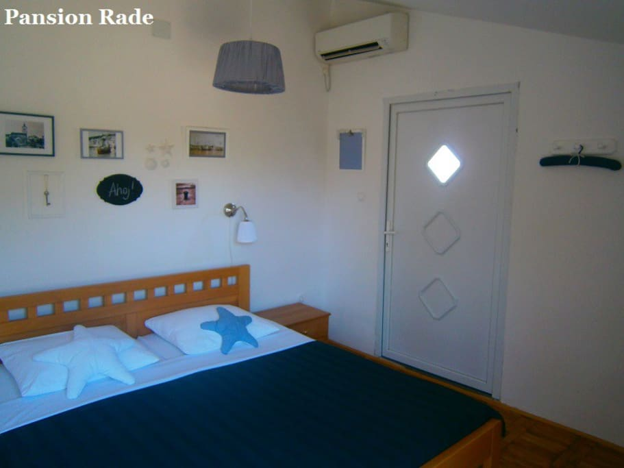 The room is equipped with queen size bed, AC, wi-fi, ...