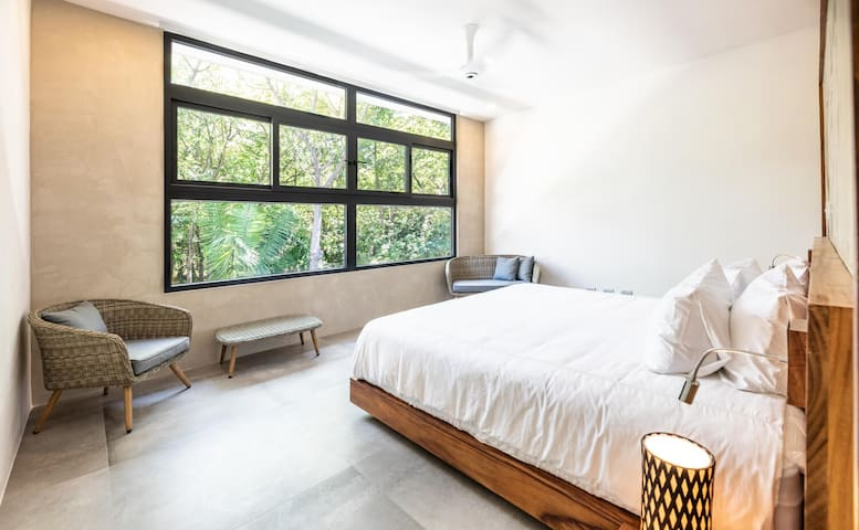 master suite with direct natural jungle views