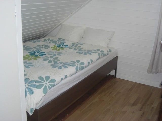 Double size bed with comfortable pillows.