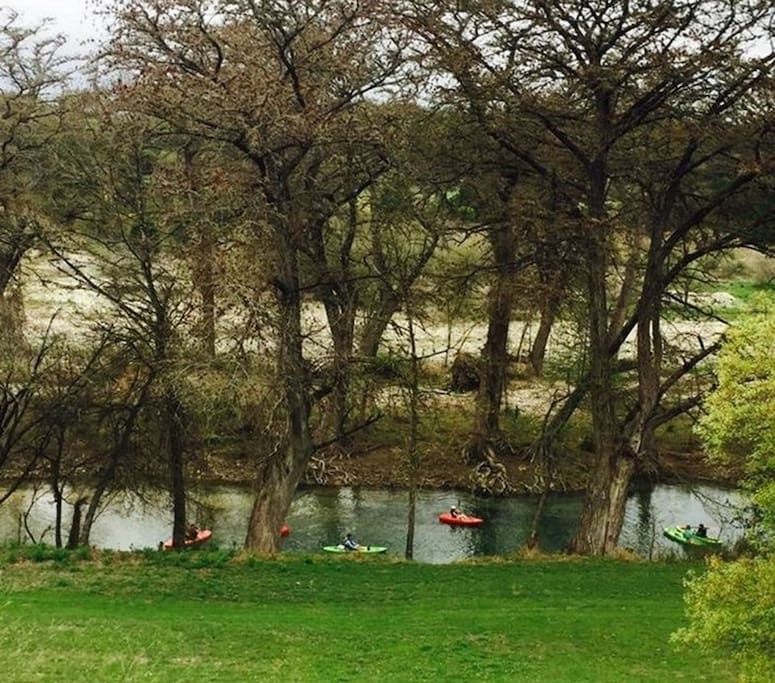 Kayakers from our back deck! River is right in our back yard