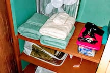 Linen closet contains extras and items you may have forgotten. Extra pillows and blankets are also found here.