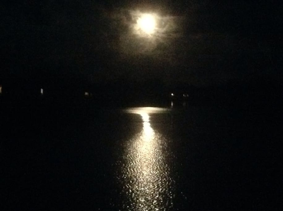 Spectacular moonrise over the water