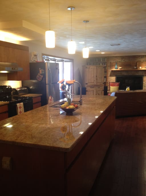 Large kitchen with granite counters and gas stove, in-fridge water system