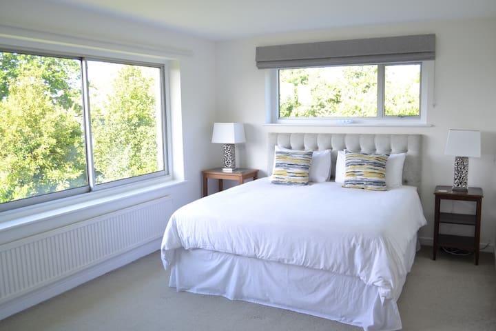 Master bedroom with super kingsize bed