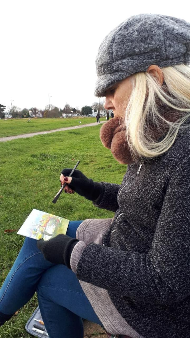 On a cold day, a guest bravely paints