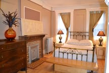 This is the bedroom in the Artist Suite. The antique brass bed accents the charm of the Artist Suite.