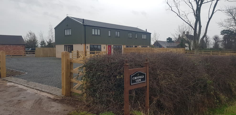Cornfield View is a trendy, modern, barn conversion in a delightful rural setting.