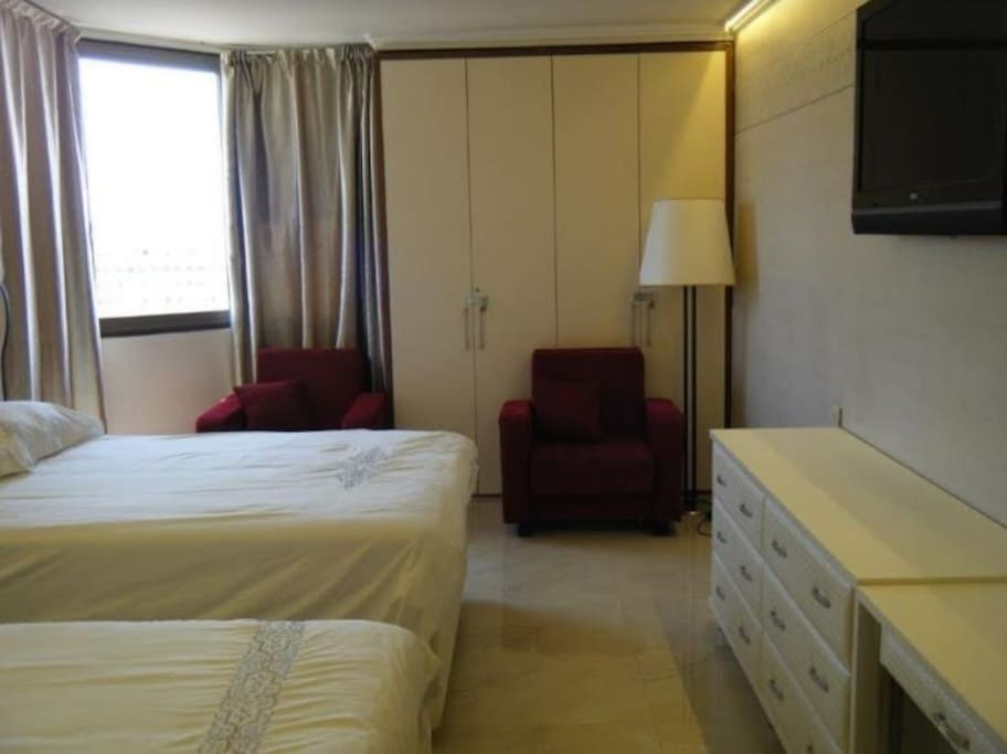 "The bedroom is furnished with 2 double beds, 42"" TV, own bathroom and balcony"