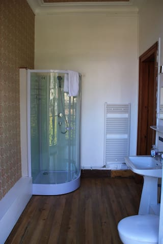 En-suite shower room with balcony.