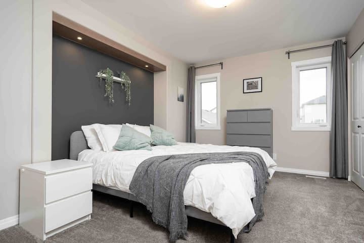Master bedroom with queen bed.  Ample drawer and closet storage with hangers available in the closet.