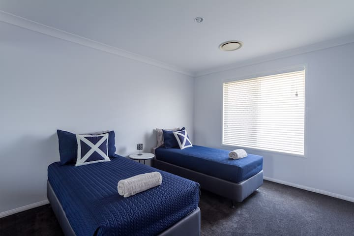 Fourth bedroom with 2 Single beds