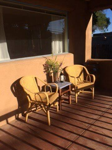 Relax on the porch with a glass of wine or orange juice to catch the morning sun.