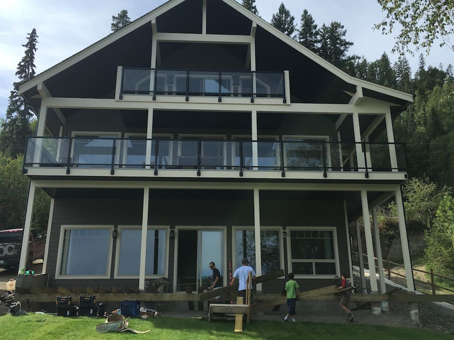View of the gorgeous 3 level home from the back, deck is now complete on the lower level.
