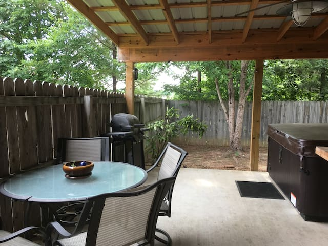 Covered patio complete with hot tub ready for your enjoyment in a private wood fenced back yard!