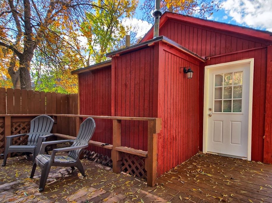 Nestled in the shade of tall trees, this cabin boasts comfort and a welcoming feel!