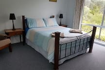 peaceful spot to wake up, New high quality mattress with comfy fluffy mattress topper and a selection of pillows.
