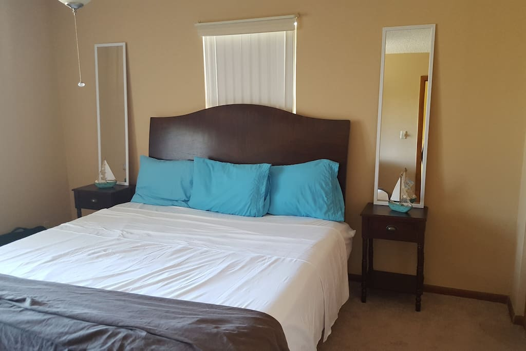 Master bedroom featuring a king size bed