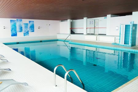 Ferienwohnung mit Schwimmbad & Sauna, Alpensicht