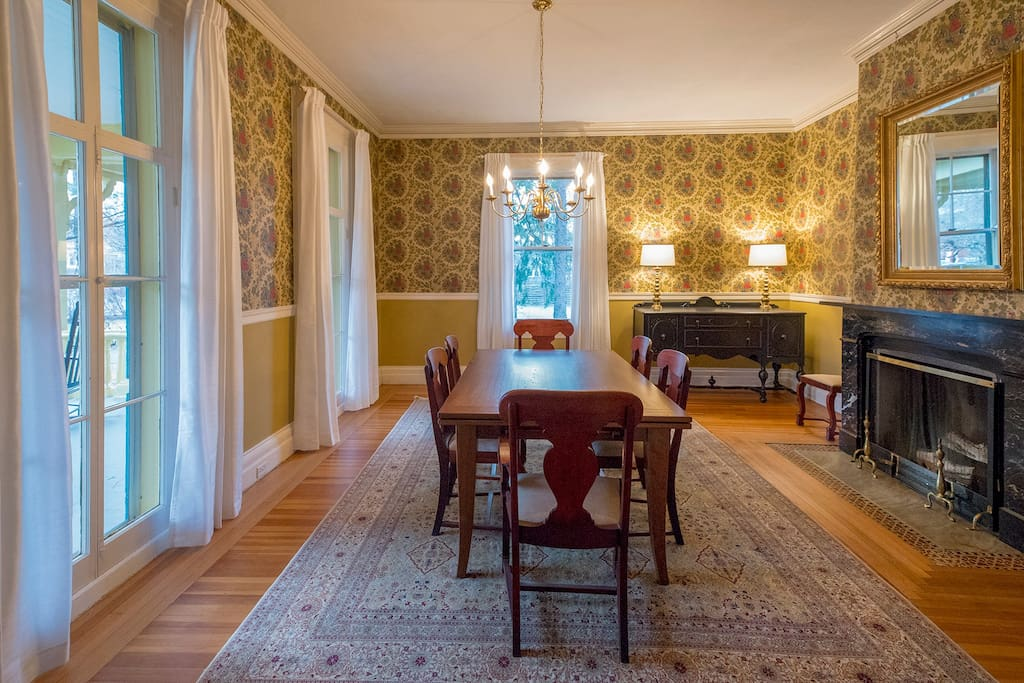 The dinning room with Italian marble fireplace and floor to ceiling windows.