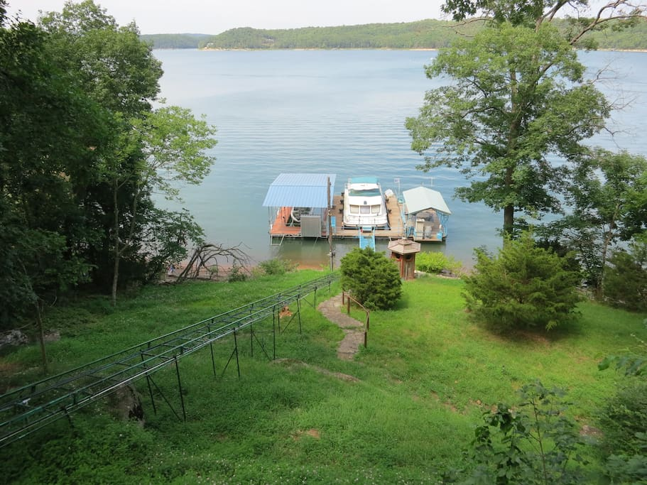View from deck looking down to swim and boat dock