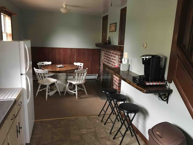 Dining room with coffee bar and keurig drinks that are provided.