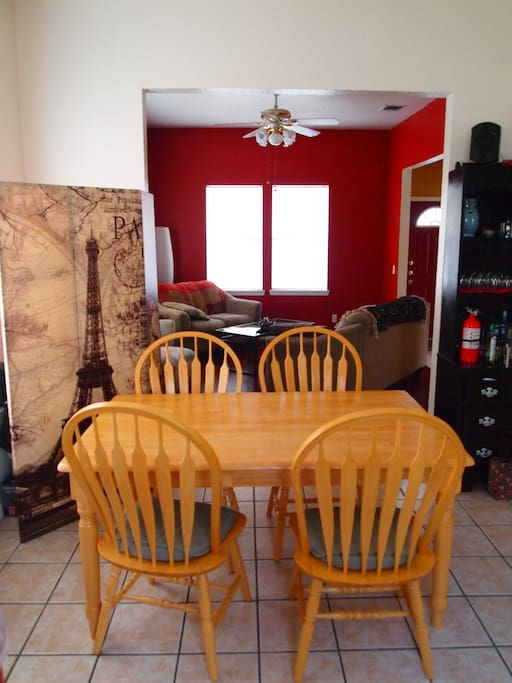 Dining table and a gas stove.