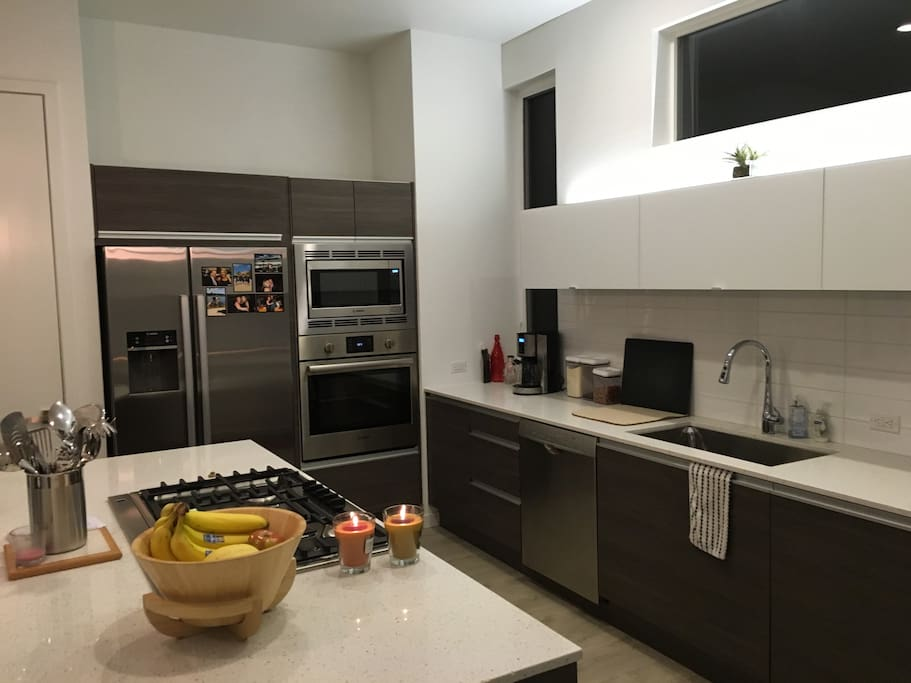 Chef's kitchen - stainless steel appliances, gas stove