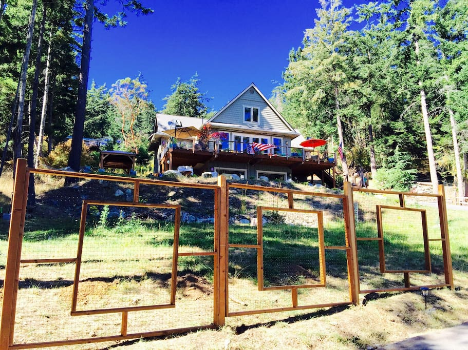 O.M.G. Is Ocean Mist Getaway.  Deer fencing and gated property.  Lower lawn with fire pit and chairs. Fruit trees and flowers abound.