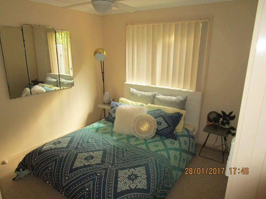 Bedroom with queen size bed and ceiling fan - gets some afternoon sun