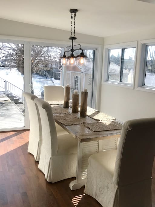 Sunny dining room overlooking expansive deck and the beautiful lagoon!