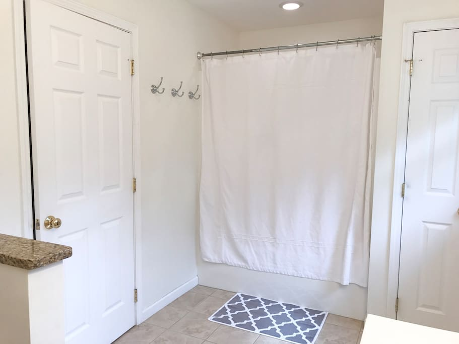 Master bath. Toilet, two sinks, and a shower with bathtub.