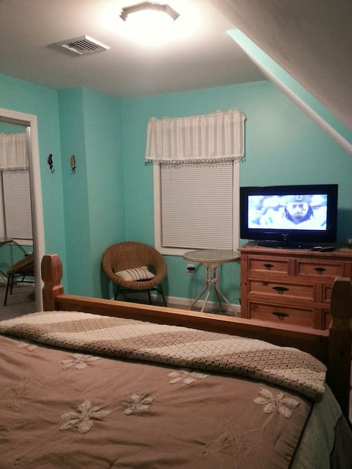 Main bed room with  TV, dresser and Closet